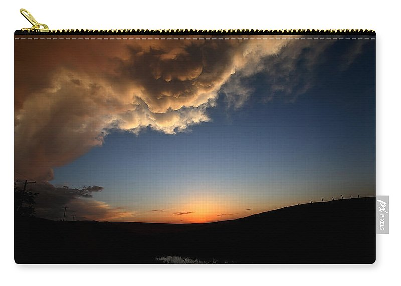 Setting Sun Carry-all Pouch featuring the photograph Sun Setting Behind The Horizon In Saskatchewan by Mark Duffy