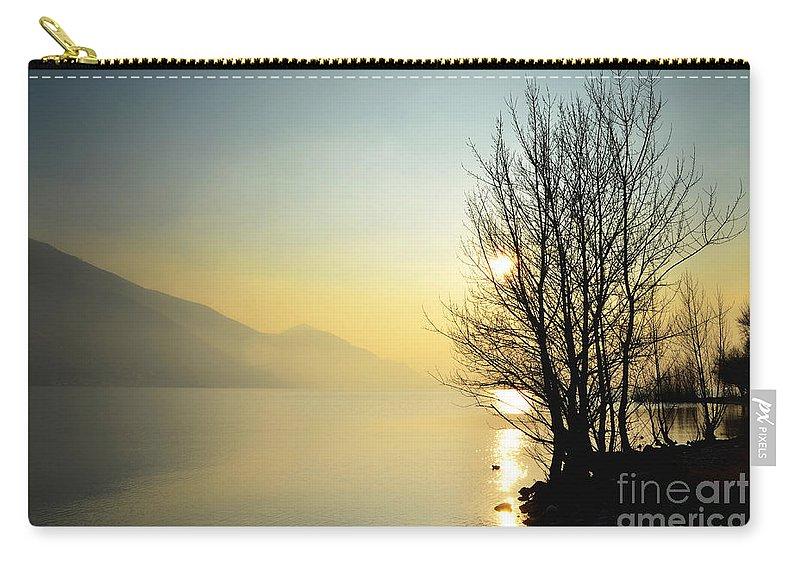 Tree Carry-all Pouch featuring the photograph Sunlight On An Alpine Lake by Mats Silvan