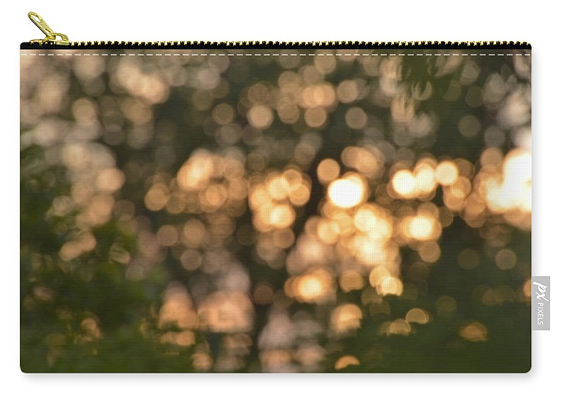 Light Carry-all Pouch featuring the photograph Sunset Bokeh by Debbie Portwood