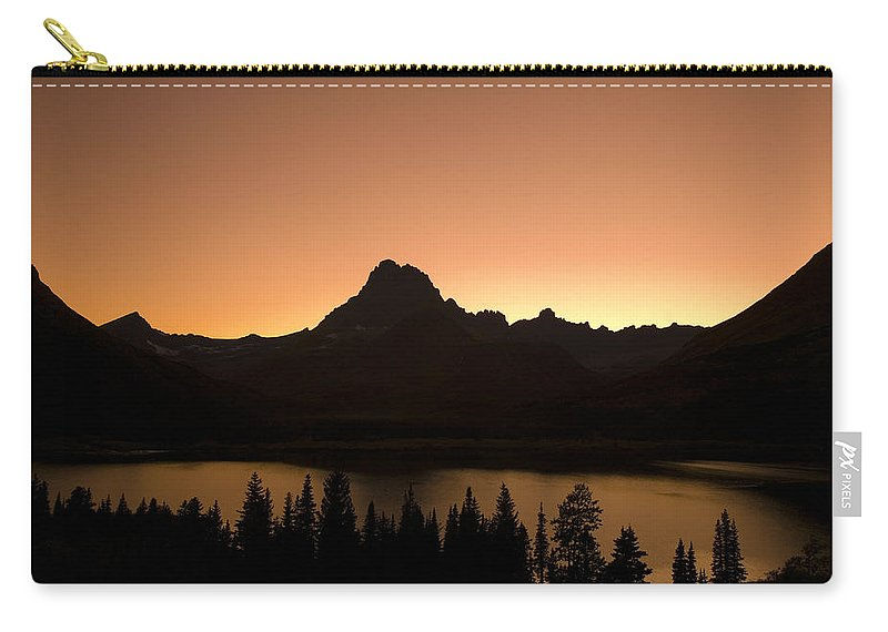 Glacier National Park Carry-all Pouch featuring the photograph Sunset Swift Current Lake Glacier National Park by Rich Franco