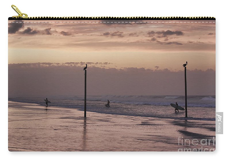 Surfers Carry-all Pouch featuring the photograph Surfers Pelicans And Pink Sky by Deborah Benoit
