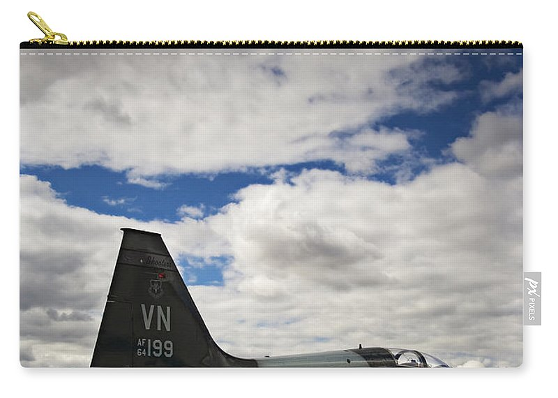 Aerodynamics Carry-all Pouch featuring the photograph Talon Time-out by Ricky Barnard