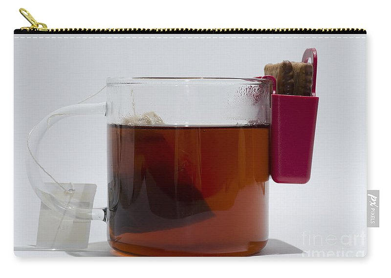 Tea Cup Carry-all Pouch featuring the photograph Tea Cup With Cookie Bag by Mats Silvan