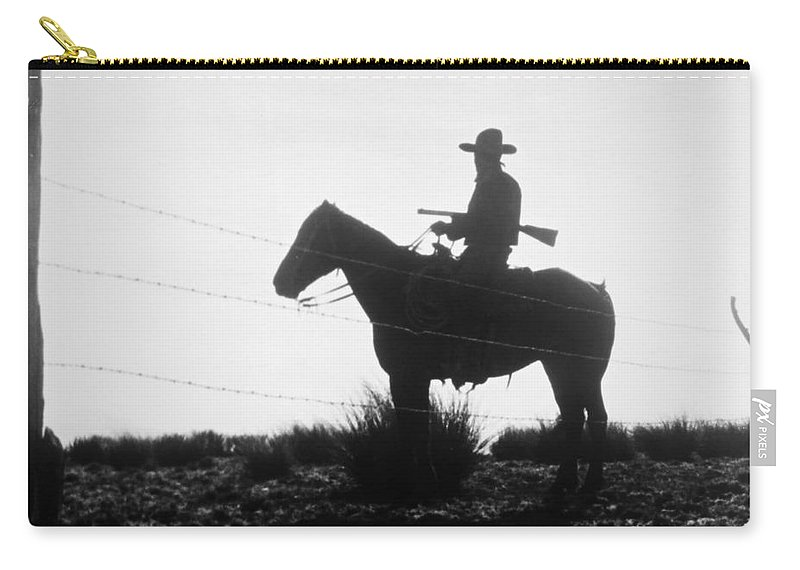 1954 Carry-all Pouch featuring the photograph The Cowboy, 1954 by Granger