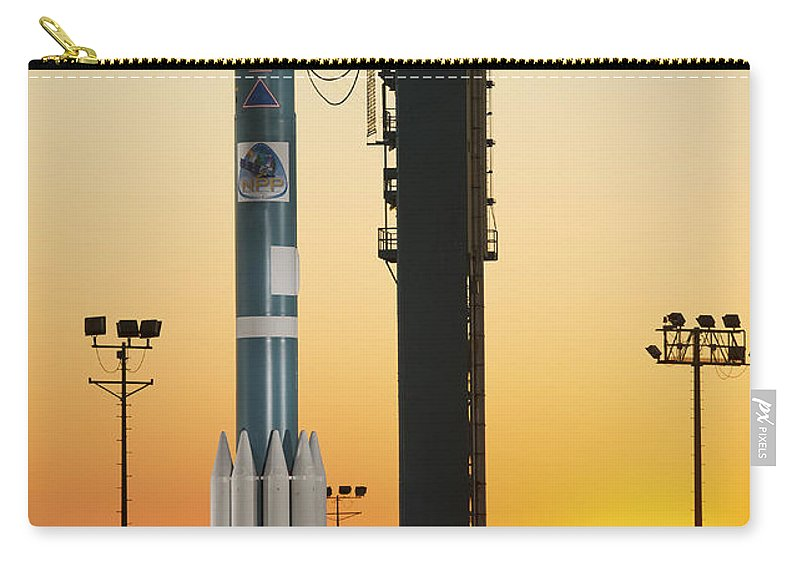 California Carry-all Pouch featuring the photograph The Delta II Rocket On Its Launch Pad by Stocktrek Images