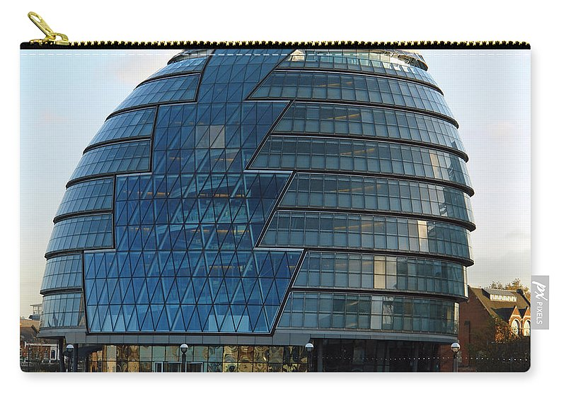 Architecture Carry-all Pouch featuring the photograph The Imposing Glass Greater London Mayoral Building On The Banks Of The Thames by Ashish Agarwal