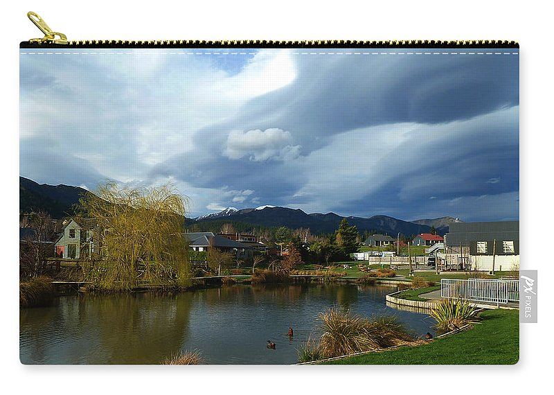 Invasion Carry-all Pouch featuring the photograph The Invasion Has Started by Steve Taylor