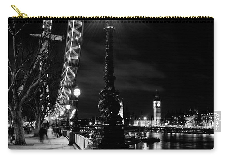 London Eye Carry-all Pouch featuring the photograph The London Eye At Night by David Pyatt