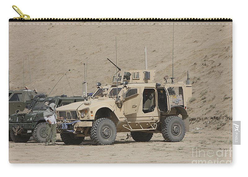 Armored Vehicles Carry-all Pouch featuring the photograph The Oshkosh M-atv Mrap by Terry Moore