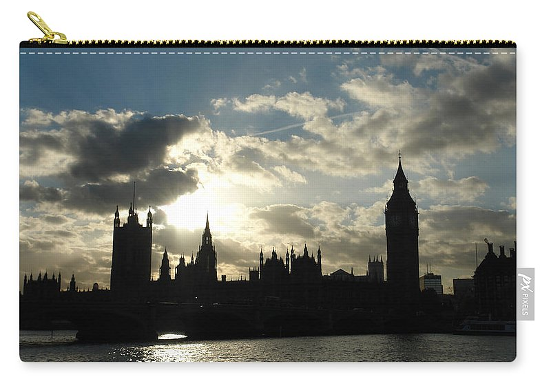 London Carry-all Pouch featuring the photograph The Outline Of Big Ben And Westminster And Other Buildings At Sunset by Ashish Agarwal