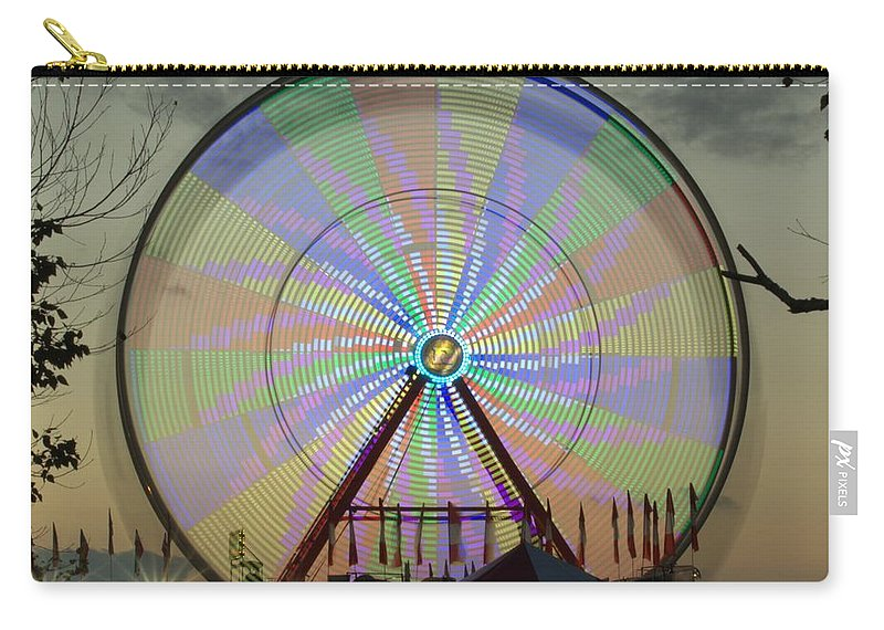 Ferris Wheel Carry-all Pouch featuring the photograph The Pinwheel Glow by Donna Brown
