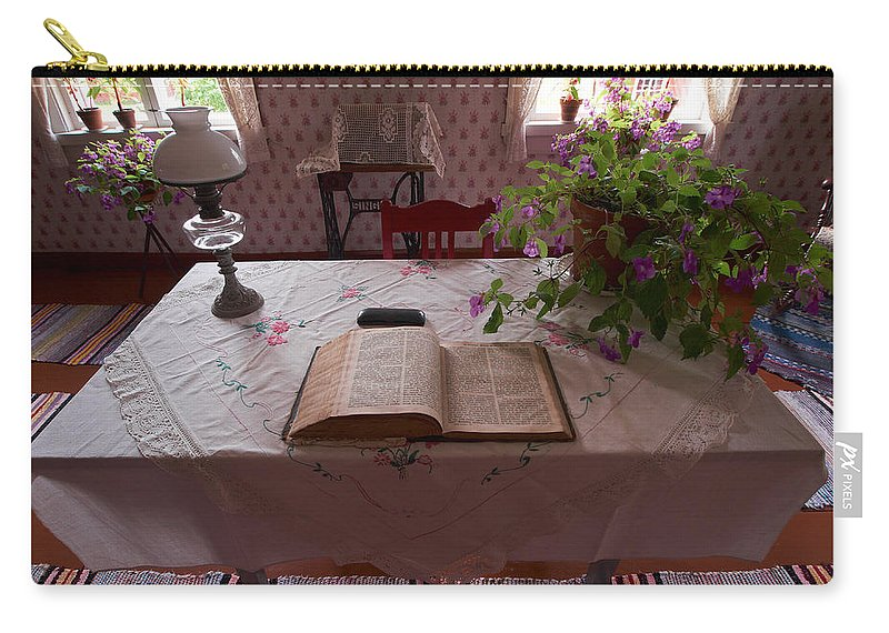 Seitseminen Carry-all Pouch featuring the photograph The Place Of The Bible In Kovero by Jouko Lehto
