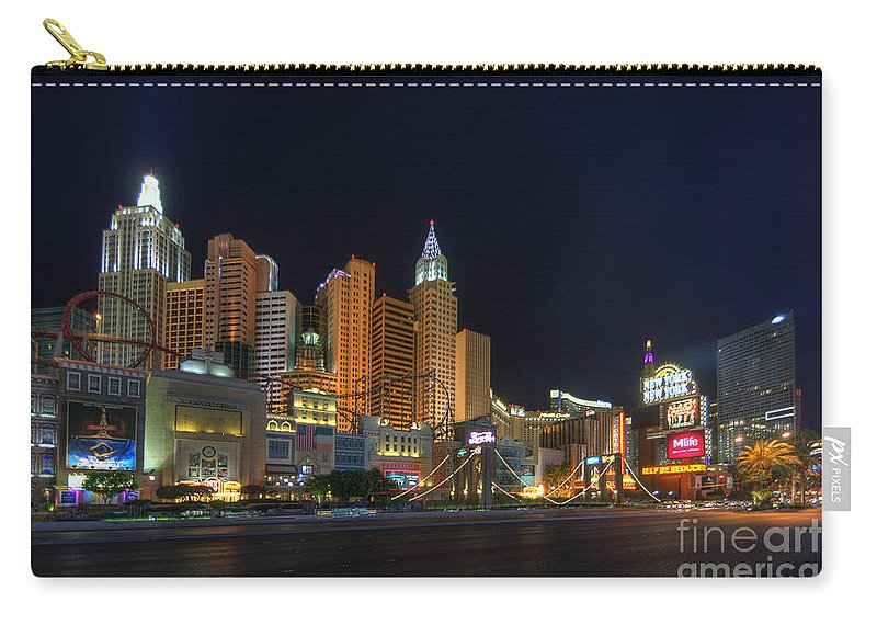 Art Carry-all Pouch featuring the photograph The Strip by Yhun Suarez