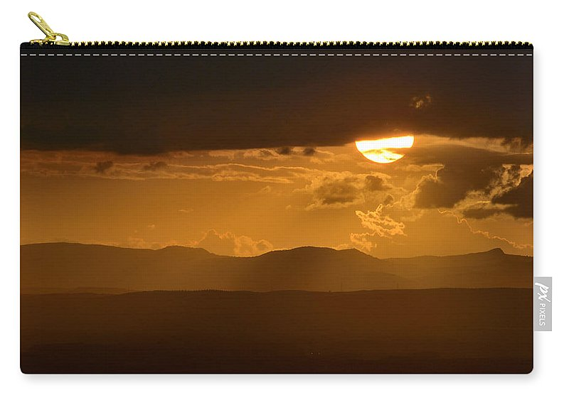 Sunset Carry-all Pouch featuring the photograph The Sun And De Storm by Guido Montanes Castillo