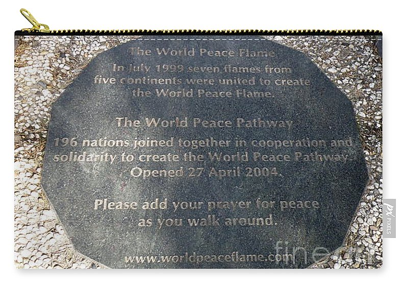 the World Peace Flame Carry-all Pouch featuring the photograph The World Peace Flame by Lainie Wrightson