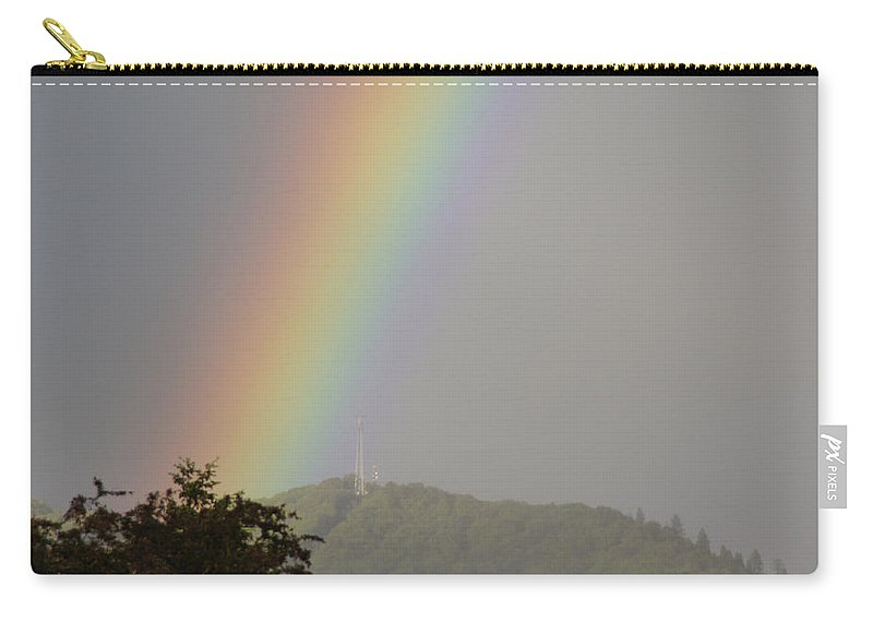 Tower Carry-all Pouch featuring the photograph Tower In The Rainbow by Mick Anderson