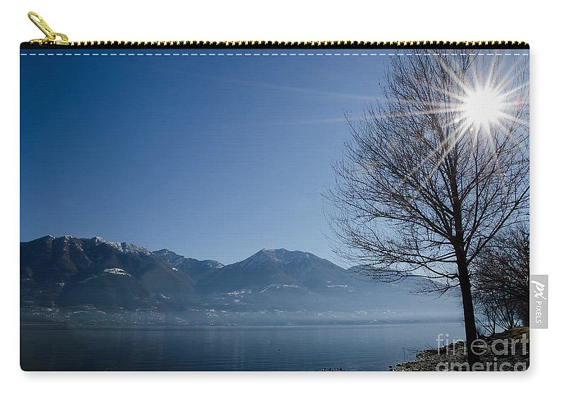 Tree Carry-all Pouch featuring the photograph Tree On Lakefront by Mats Silvan