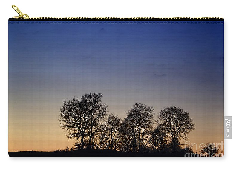 Trees Carry-all Pouch featuring the photograph Trees On A Hill In Sunset by Mats Silvan