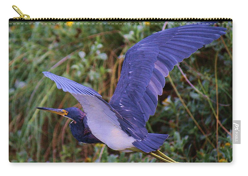 Roena King Carry-all Pouch featuring the photograph Tricolored Heron In Flight by Roena King