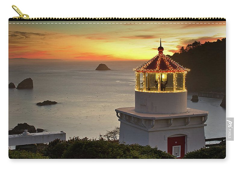 Christmas Lights Carry-all Pouch featuring the photograph Trinidad Memorial Lighthouse Sunset by Greg Nyquist