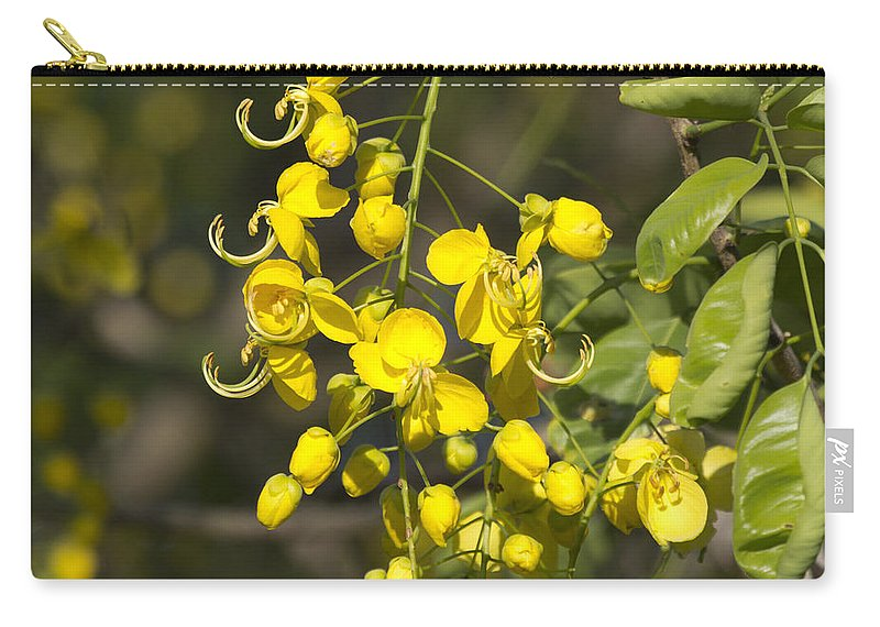 Tropical Yellow Carry-all Pouch featuring the photograph Tropical Yellow Flowers by Douglas Barnard