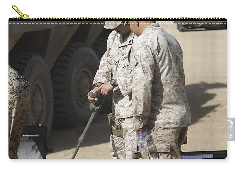 Explosive Ordnance Disposal Carry-all Pouch featuring the photograph Two U.s. Marines Use A Mine Detector by Terry Moore