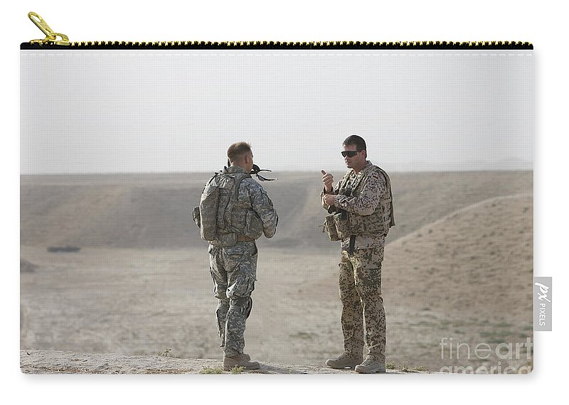 Us Army Carry-all Pouch featuring the photograph U.s. Army Soldier And German Soldier by Terry Moore