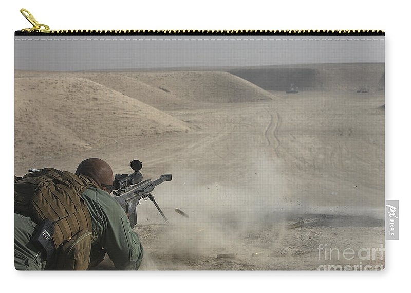 Isaf Carry-all Pouch featuring the photograph U.s. Army Soldier Fires A Barrett M82a1 by Terry Moore