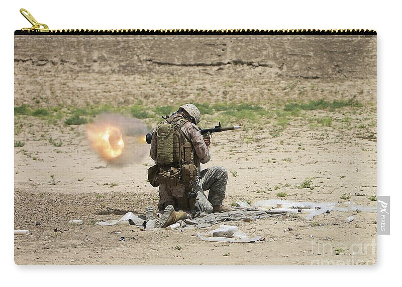 Afghanistan Carry-all Pouch featuring the photograph U.s. Army Soldier Fires by Terry Moore