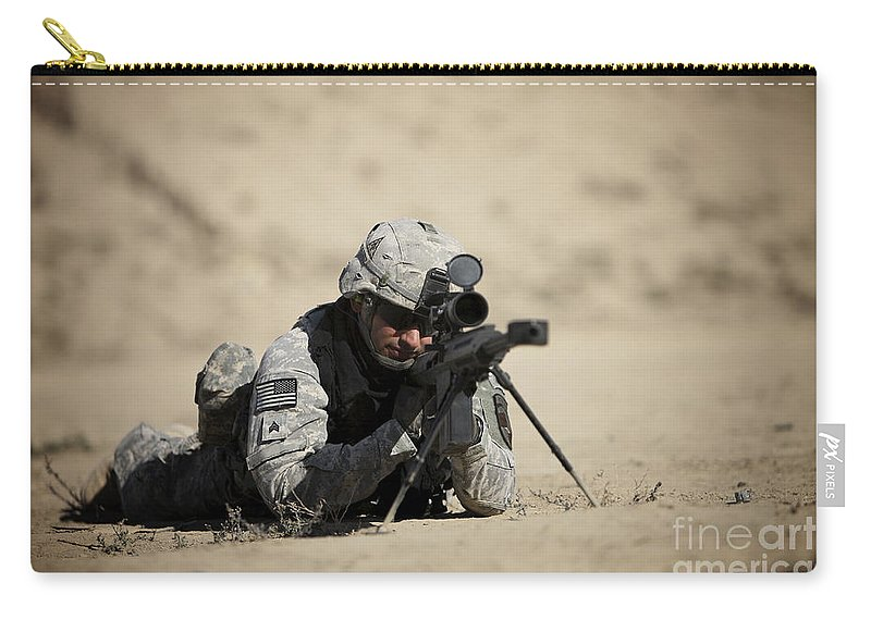 Operation Enduring Freedom Carry-all Pouch featuring the photograph U.s. Army Soldier Sights In A Barrett by Terry Moore