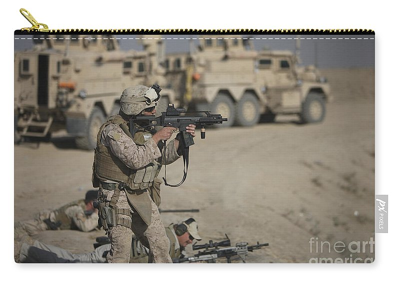 Operation Enduring Freedom Carry-all Pouch featuring the photograph U.s. Marine Fires A G36k Carbine by Terry Moore