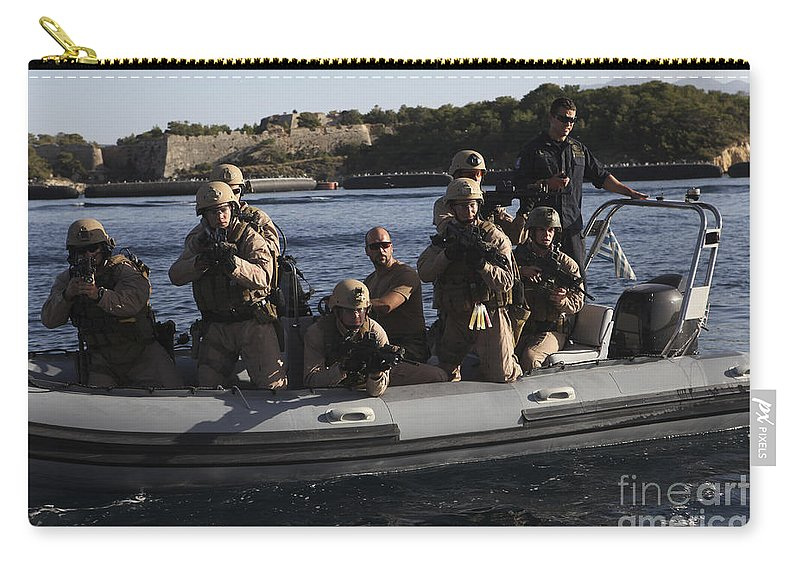Deployment Carry-all Pouch featuring the photograph U.s. Marines Approach A Suspect Vessel by Stocktrek Images