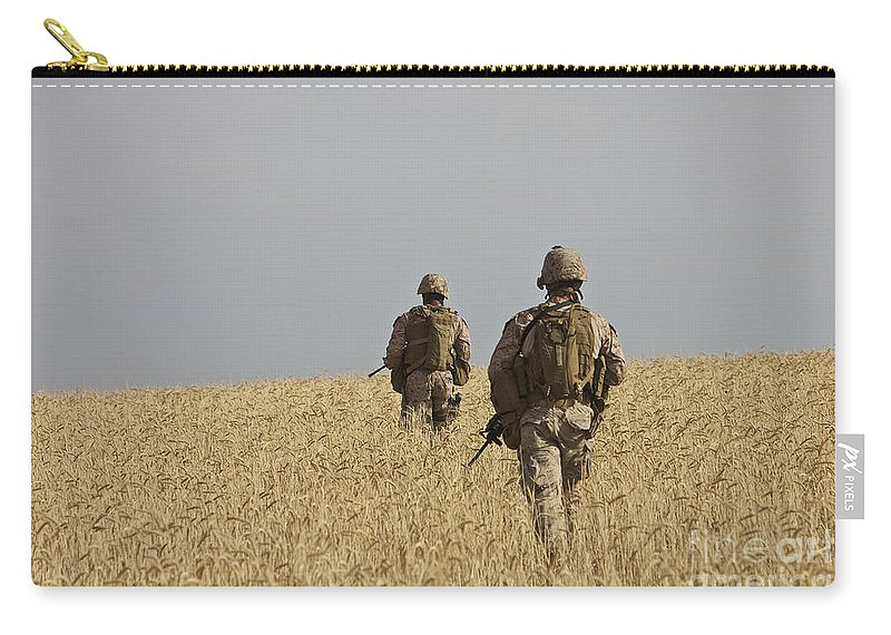 Afghanistan Carry-all Pouch featuring the photograph U.s. Marines Patrol A Wadi Near Kunduz by Terry Moore