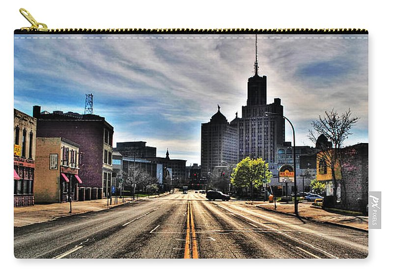 Carry-all Pouch featuring the photograph View Down Broadway Into Downtown Buffalo Ny Vert by Michael Frank Jr