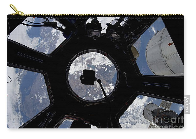 Space Station Carry-all Pouch featuring the photograph View Of Earth Through The Cupola by Stocktrek Images