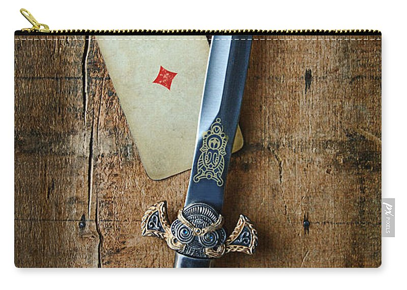 Knife Carry-all Pouch featuring the photograph Vintage Dagger On Wood Table With Playing Card by Jill Battaglia