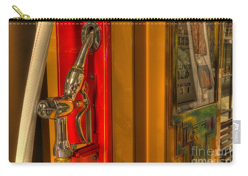 Classic Gas Pumps Carry-all Pouch featuring the photograph Vintage Gas Pump Nozzle by Bob Christopher