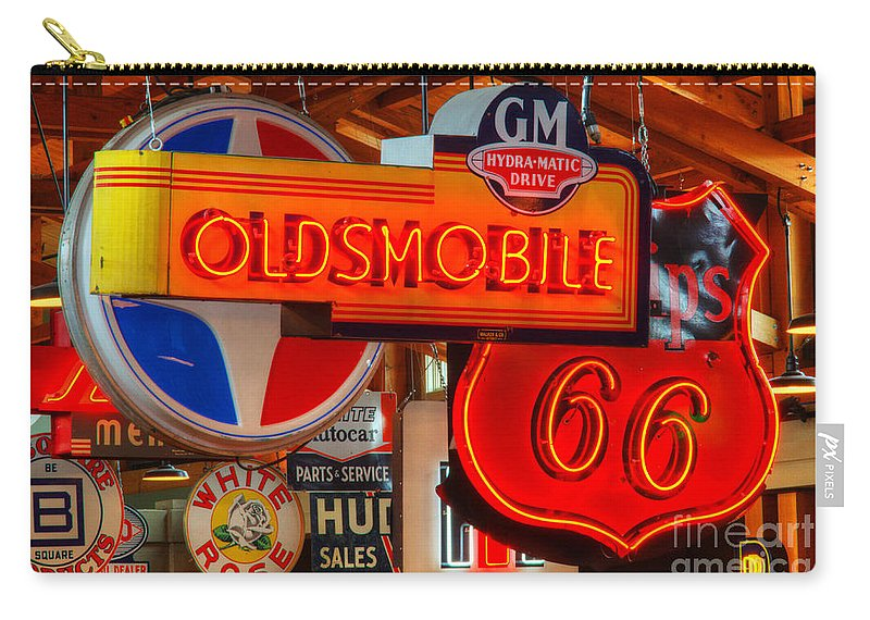 Classic Signs Carry-all Pouch featuring the photograph Vintage Neon Sign Oldsmobile by Bob Christopher