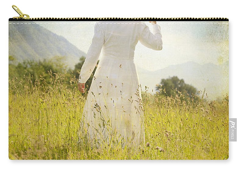 Female Carry-all Pouch featuring the photograph Walking On The Meadow by Joana Kruse