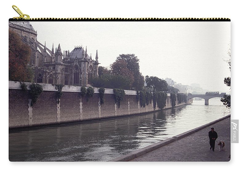 Paris Carry-all Pouch featuring the photograph Walking The Dog Along The Seine by Tom Wurl