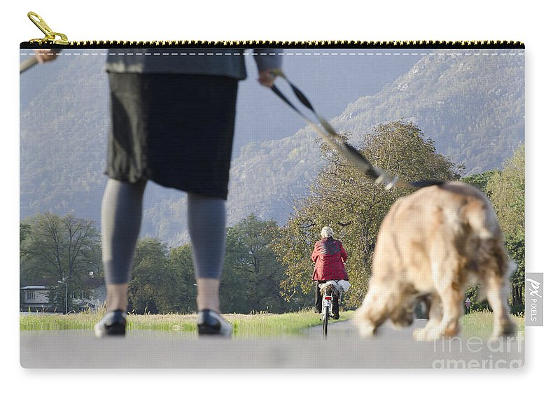 Woman Carry-all Pouch featuring the photograph Walking With Her Dogs by Mats Silvan