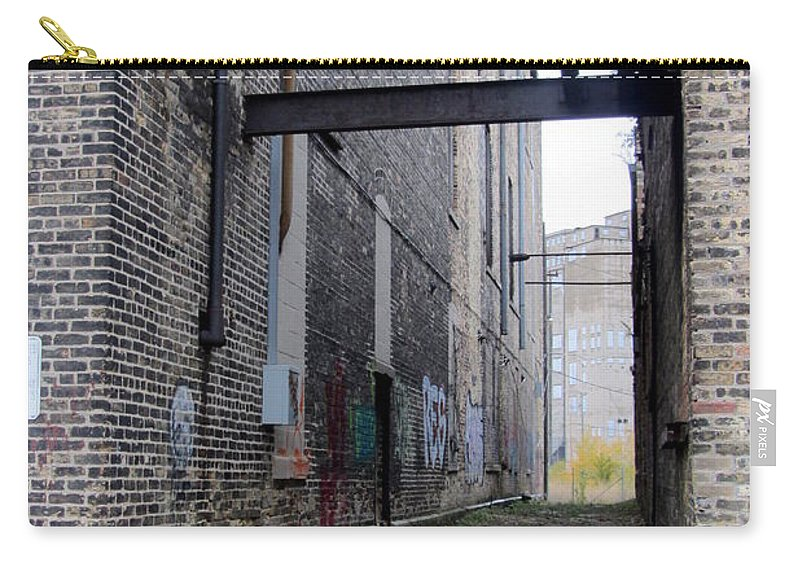 Milwaukee Carry-all Pouch featuring the photograph Warehouse Beams And Grafitti by Anita Burgermeister