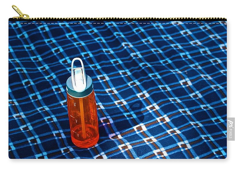 Water Bottle Carry-all Pouch featuring the photograph Water Bottle On A Blanket by Eric Tressler