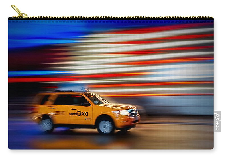 New York City Taxi Carry-all Pouch featuring the photograph Whizzing Along by Susan Candelario