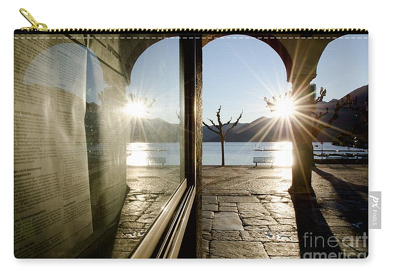 Alley Carry-all Pouch featuring the photograph Window And Sun by Mats Silvan