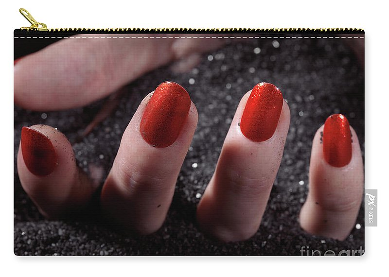 Manicure Carry-all Pouch featuring the photograph Woman Hand With Red Nail Polish Buried In Black Sand by Oleksiy Maksymenko