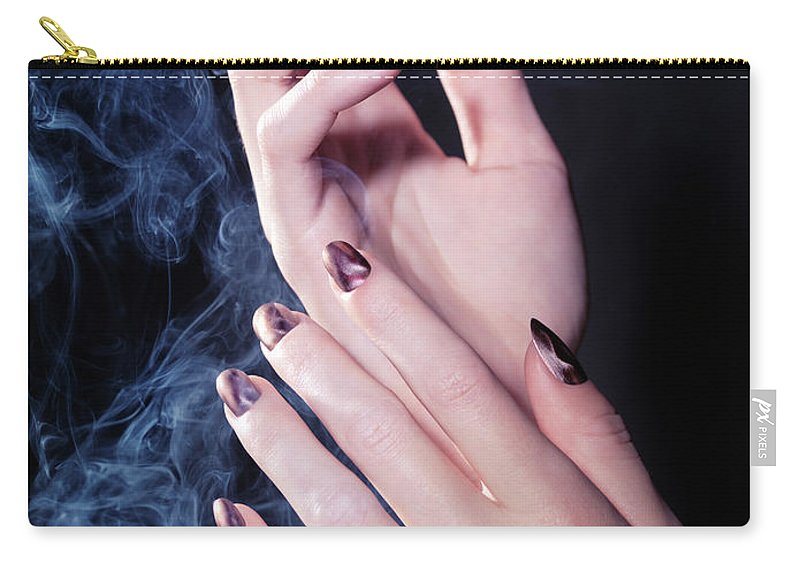 Hands Carry-all Pouch featuring the photograph Woman Hands In A Cloud Of Smoke by Oleksiy Maksymenko