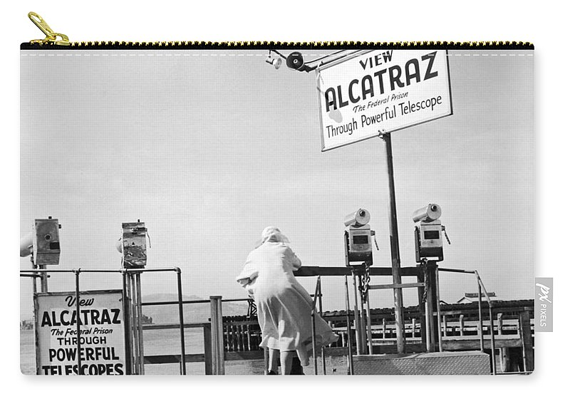 1950's Carry-all Pouch featuring the photograph Woman Looking At Alcatraz by Underwood Archives