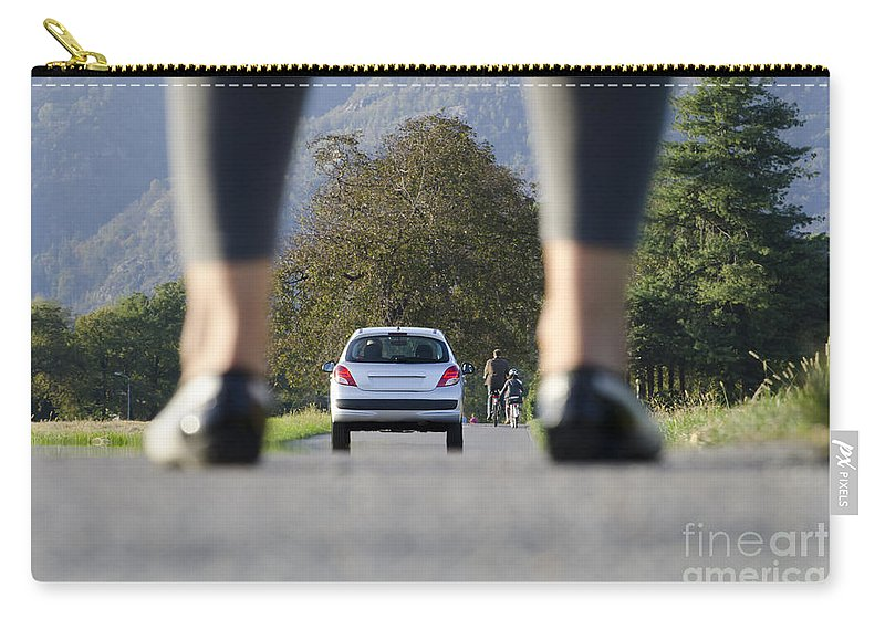 Woman Carry-all Pouch featuring the photograph Woman Standing On A Road by Mats Silvan