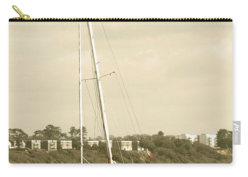 Yacht Carry-all Pouch featuring the photograph Yacht Entering Christchurch Harbour by Chris Day